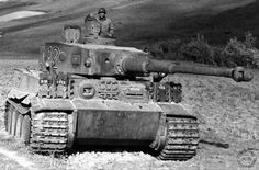 """""""A Tiger tank captured in Tunis, 1943"""" - this photo shows """"712"""" soon after capture and with an American crew - note the 'Stalking Tiger' insignia of Schwere Panzer-Abteilung 501 just above the driver's vision block (Credit: Wikimedia)"""