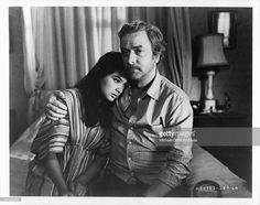 Elpidia Carrillo is comforted by her husband Michael Caine in a scene from the…