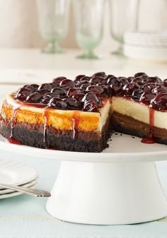 Cherry-Glazed Black Bottom Cheesecake-Here's the cheesecake version of the classic German dessert, Black Forest cake—made with chocolate and cherries on a chocolatey cookie-crumb crust.