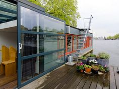 If you're looking for your very own dreamboat, look no further. We've rounded up some of the world's coolest houseboats that you can call home for just a night or two or drop anchor forever.