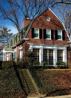 In an unusual twist for the neighborhood, this Dutch Colonial turns its gambrel-roofed end toward the street. Dutch Colonial Exterior, Dutch Colonial Homes, Colonial Mansion, Gambrel Roof, Dutch House, Tudor Style Homes, Unusual Homes, Beautiful Buildings, Architecture