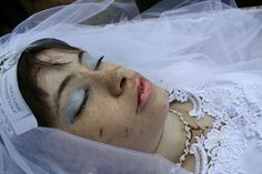 Woman in her open casket during her funeral.