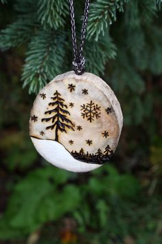 Give your holiday hostess a special handmade gift this year. A driftwood slice ornament with a beautiful Winter Wonderland scene burnt into the