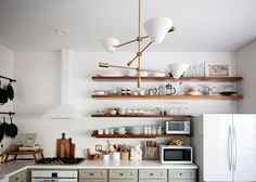 A Home Combines Purpose with Poise In The Woodlands, TX – Design*Sponge Diy Kitchen Shelves, Wooden Kitchen, Interior Design Kitchen, Modern Interior Design, Kitchen Queen, Green Cabinets, Kitchen Fixtures, Home Decor Inspiration, Home And Living