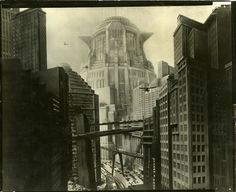 Vintage futuristic city photograph from Fritz Lang's Metropolis. A period 8 x 10 in. gelatin silver, glossy, black-and-white photograph on heavy paper from the classic sci-fi masterpiece Metropolis. Depicting the futuristic landscape of the title city with miniature set pieces, models and scenic background paintings.