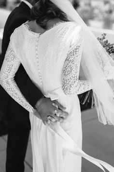 modest wedding dress with long lace sleeves and a slim skirt from alta moda. -- (modest bridal gown)