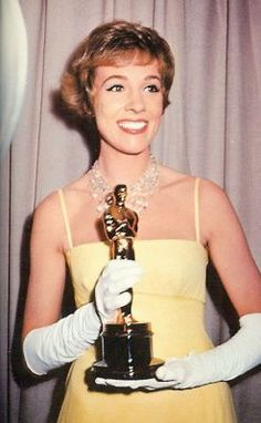 Oscars 1965 - Julie Andrews WON the  Best Actress Oscar for her iconic role playing Mary Poppins in the eponymous film.  She was wearing a bright yellow A-line dress and gorgeous diamond fringe necklace.