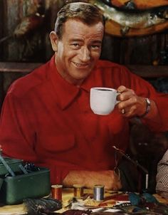 John Wayne ties some flies.