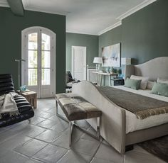 Farrow and Ball Green Smoke on the walls and Cornforth White Floor Paint for the old terracotta tiles. La Albaida Decoración.