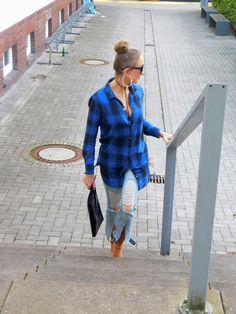 SHADES OF K  by Karen   wearing distressed jeans with raw hem, blue and black plaid shirt, nude heels, oversized hoop earrings, stacked bracelets, black choker necklace, and studded oversized clutch.