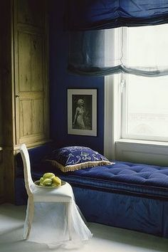 cobalt blue bench , wall and stores from metropolitan home