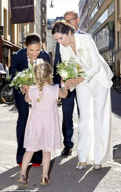 Both royals were delighted to be presented with bouquets by a little girl in a summery floral dress and rose gold sandals