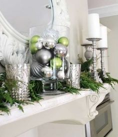 Holiday mantle - balls in hurricane holder would work as a centerpiece as well (. - Holiday mantle – balls in hurricane holder would work as a centerpiece as well (my preference wou - Silver Christmas, Noel Christmas, Green Christmas, Christmas Colors, Simple Christmas, Elegant Christmas, Christmas Christmas, Tv Stand Christmas Decor, Christmas Ornaments