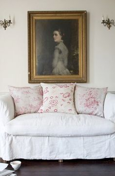 White linen & floral cushions (Cabbages and Roses, I think).