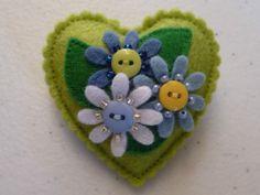 Felt heart brooch - I like the beading details...maybe on matryoshkas