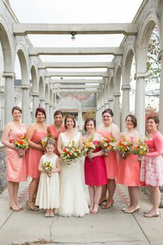 coral bridesmaids in assorted dresses