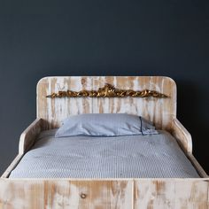 rustic hand-made bed made from reclaimed wood