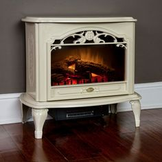 The Dimplex Celeste Freestanding Electric Stove in Cream operates with or without heat. This electric wood stove has a fan forced heater to gently warm your space. Electric Wood Stove, Electric Stove Fireplace, Electric Fireplaces Direct, Fireplace Heater, Paint Fireplace, Fireplace Tv Stand, White Fireplace, Fireplace Bookshelves, Electric Fires