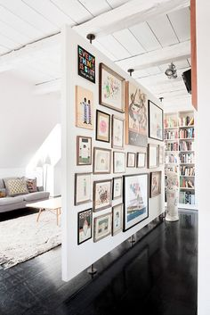 Floating gallery wall room divider.