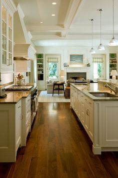 A LIVING Kitchen will be in my next home! <3 the double sinks! I want a lot of glass cabinetry!