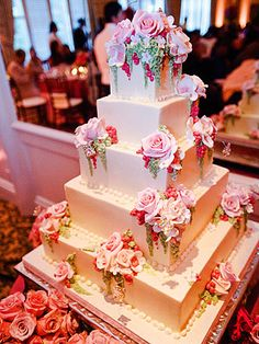 Mowry showcased a stunning four-tier vanilla and red velvet confection decorated with pink roses by Cake Divas at her California celebration.
