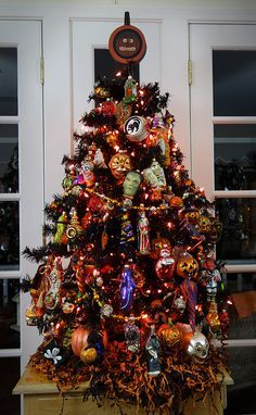 CHRISTMAS TREE~A black Halloween tree filled with Old World Christmas, Slavic and Radko Halloween ornaments.
