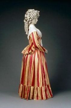 Woman's dress in two parts (caraco jacket) French, about 1785–90. Silk satin, braid trim. Note: Stripes run down the sleeves.