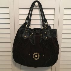Juicy couture black handbag Velvet outside. Red on the inside. Very good condition / no marks Juicy Couture Bags Shoulder Bags