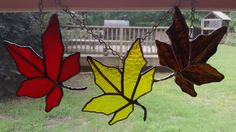 Autumn leaves! These will never dry up and fall apart! Stays spectacular, year round.  This leaf is made with a stunning red and orange glass named Autumn Flame, very appropriate! Although opaque, the light transmission the glass allows emits a bright glow of color! I added a handmade stem to make each and every one unique. No two will be alike! A dark pewter patina has been used to give the solder an aged look.  Perfect for a pop of color in a dorm, in a window, anywhere you need a…