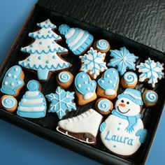 Snowman, tree, mittens, hat and snowflakes and skate all in blue and white cuteness.