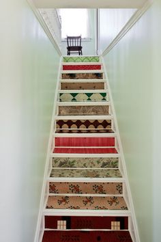 Six decades of linoleum floor covering reused on stair treads and risers. Nice!