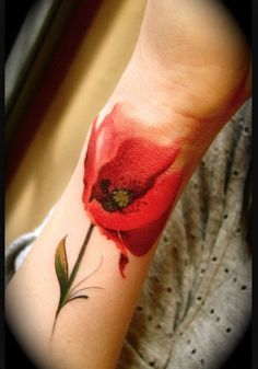 Love this poppy tattoo, the fading is beautiful http://tattooideas247.com/flower-tattoos