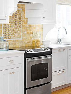 """Use a pattern within a pattern to set your backsplash apart from the crowd. Backing this range with diminutive subway tiles around a centerpiece basket-weave design created a sunny scene stealer in this kitchen. Dressed in varied tones of butter and golden yellow, the patterns are defined by liner tiles framing horizontal and vertical rectangular tiles, alternating with gray dots to cleverly create the """"over and under"""" effect."""