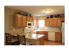 Large kitchen, oak laminate flooring, breakfast bar, corner sink and huge pantry, dining area with glass sliders to large deck!