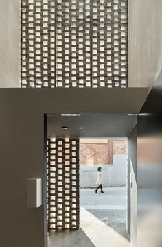 Beyond the Screen apartment block with brickwork screen by OBBA