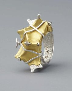 Ring | Johanna Dahm. 'Enhancement 8, 2012'.  Silver and gold.  Her Enhancement series uses the casting techniques of the African Ashanti and Indian Dokra.  Pure silver rings are then decorated with pure gold, pearls or raw diamonds.
