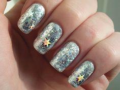 Stars & snowflakes. #sparkle #nailart #mani