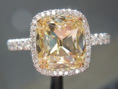 A little more realistic, 2.5 center yellow diamond, cushion cut, halo and, total 3 carats. I would be VERY happy with this!