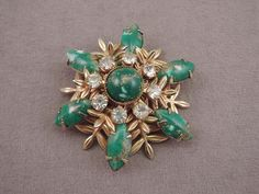 Gold Tone, Green Gold Fleck Cabochon, and Rhinestone Snowflake/Floral Pin by thejeweledbear on Etsy