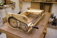 Router Lathe - Homemade router lathe constructed from plywood, shafting, bushings, a router, bicycle chains, and bicycle chainrings.