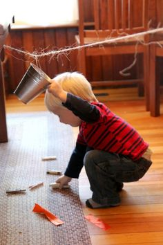 A simple activity that toddlers will love - with just a bucket and a clothesline!