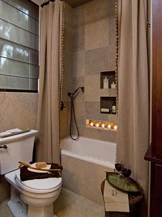 See a small earthy bathroom with a neutral color pallet and mosaic niches featured on HGTV.com.