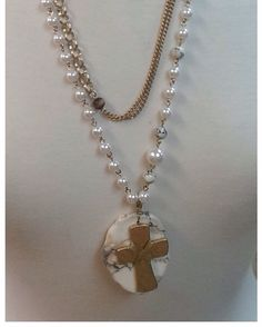 Wooden Beads and Black and White Line Stone Cabochon Bead on Layered Gold Wheat Chain Link, Oval Chain Link, and Pearl and Gold Wheat Necklace with a Gold Wire Wrap Cross on a Black and White Line Flat Stone Cabochon Pendant 50% Percent Off Clearance Rack In-Store Only