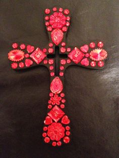 Wood cross painted black and decorated with red rhinestones.