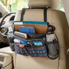 The perfect driving companion for water, sanitizer, masks, phones, sunglasses and so much more - and it swings to the back for passenger access!