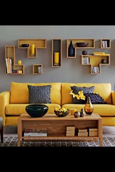 Mustard and grey sitting room. Love this!!!!! Great use of box shelving