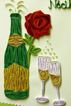 Gorgeously quilled anniversary card was has an open bottle of champagne and two glasses on front - a large textured red rose decorates the bottle