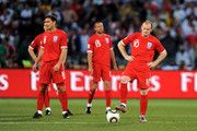 Dejected Frank Lampard and Wayne Rooney of England restart the match during the 2010 FIFA World Cup South Africa Round of Sixteen match between Germany and England at Free State Stadium on June 27, 2010 in Bloemfontein, South Africa.