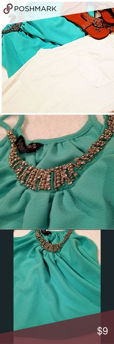 RUE 21 TEAL COLORED CROP TOP 🌟💸 BUNDLE & SAVE!  Rue 21 teal green spaghetti strap tank top  Beaded silver around neckline Size small 95% Polyester    5% Spandex Gently worn Looks new Rue 21 Tops Tank Tops