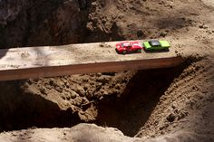 Building bridges in a dirt pit is entertaining for children. So many possibilities.